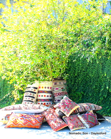 selection of camel bags and floor cushions from Nomadic Son